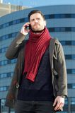 Portrait of a trendy man talking on mobile phone Royalty Free Stock Photos