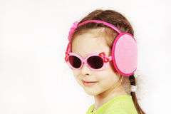 Portrait of a trendy smiling cute little girl with sunglasses Stock Photo