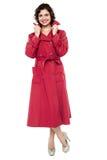 Portrait of a trendy woman in maroon overcoat Stock Photos