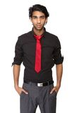 Portrait of a trendy young man in black shirt and tie Royalty Free Stock Images