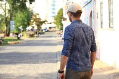 Portrait of trendy young man in the city Royalty Free Stock Photo