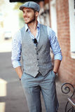 Portrait of trendy young man in the city Royalty Free Stock Photos