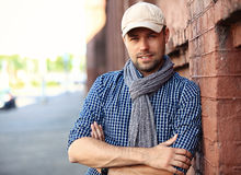 Portrait of trendy young man in the city Stock Images