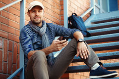 Portrait of trendy young man in the city Royalty Free Stock Photography