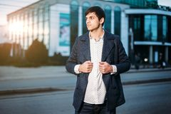 Portrait of trendy young man in city. evening royalty free stock photos
