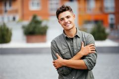 Portrait of a trendy young man in the city street. Portrait of a trendy young man in the city Royalty Free Stock Photo