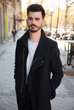 Portrait of a trendy young man in the city. Urban hipster Royalty Free Stock Images