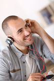Portrait of trendy young man with headphones Stock Photography