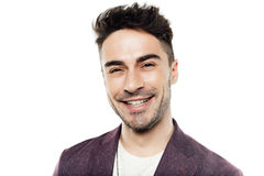 Portrait of trendy young man smiling and looking at camera Stock Images