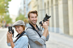 Portrait of trendy young photo reporters Royalty Free Stock Image