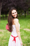 Portrait of trendy young woman in funky white dress smiling Stock Photography
