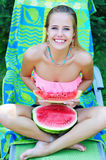 Portrait of a trendy young woman holding watermelon slice Royalty Free Stock Images