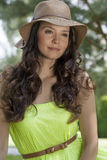 Portrait of trendy young woman wearing sunhat in park stock image