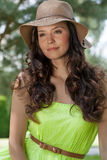 Portrait of trendy young woman wearing sunhat in park royalty free stock images