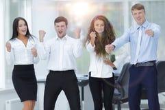 Portrait of a triumphant business team stock images
