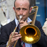 Portrait of a trombone player. Royalty Free Stock Image