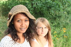 Portrait of tropical woman and caucatian girl Royalty Free Stock Images