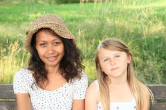 Portrait of tropical woman and caucatian girl Stock Photo