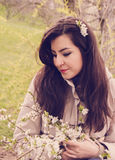 Portrait of Turkish girl holding spring cherry flowers Royalty Free Stock Image