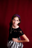Portrait of a Tween on a Deep Red Backdrop. Studio portrait of a confident tween on a deep red backdrop Stock Photos
