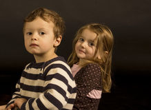 Portrait of Twins. Portrait of fraternal twins in a studio setting stock photography