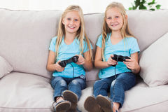 Portrait of twins playing video games together Royalty Free Stock Image