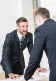 Portrait of two angry businessmen in suits Royalty Free Stock Photos