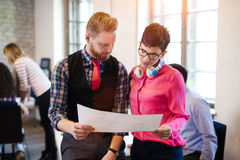 Portrait of two architects looking at project scheme Royalty Free Stock Photo