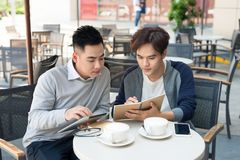 Portrait of two asian Business people Working with tablet In caf. E Royalty Free Stock Photo