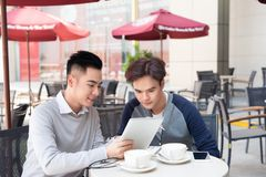 Portrait of two asian Business people Working with tablet In caf Royalty Free Stock Photos