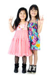 Portrait of two asian happy sisters having fun. Portrait of two asian  happy sisters having fun isolate on white background Stock Photos