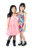 Portrait of two asian happy sisters having fun. Portrait of two asian  happy sisters having fun isolate on white background Royalty Free Stock Images
