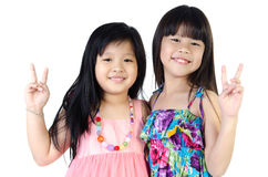 Portrait of two asian happy sisters having fun. Portrait of two asian  happy sisters having fun isolate on white background Royalty Free Stock Photography