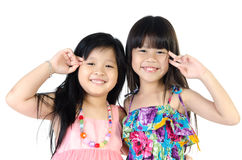 Portrait of two asian happy sisters having fun. Portrait of two asian  happy sisters having fun isolate on white background Royalty Free Stock Photos