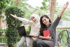 Two asian college student using laptop Stock Photo