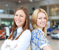 Portrait of two attractive caucasian smiling business women. In car service Stock Images