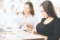 Females at workplace Royalty Free Stock Images