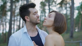 Portrait of two attractive young people, guys and girls in the pine forest. stock video footage