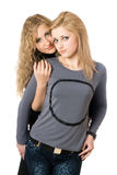 Portrait of two attractive young women. Isolated Royalty Free Stock Image