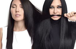 Portrait of two Beautiful brunette girls with healthy long hair Royalty Free Stock Photo