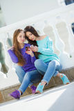 Portrait of two beautiful girlfriends in town Royalty Free Stock Photos