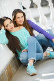 Portrait of two beautiful girlfriends in town Royalty Free Stock Photo