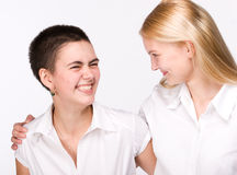 Portrait of two beautiful girls. Standing face to face, smiling Royalty Free Stock Photography