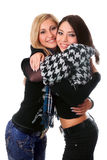 Portrait of two beautiful girls embracing Royalty Free Stock Image