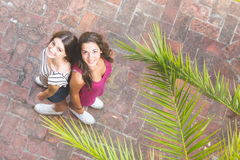 Portrait of two beautiful girls taken from above. Royalty Free Stock Image
