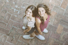 Portrait of two beautiful girls taken from above. Royalty Free Stock Photos