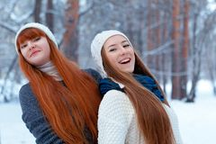 Portrait of two beautiful girls in winter park Stock Images