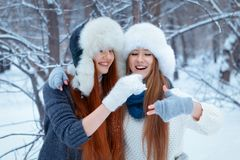 Portrait of two beautiful girls in winter park Stock Image
