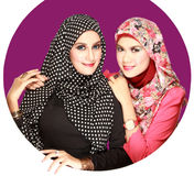 Portrait of two beautiful muslim woman having fun Stock Photo