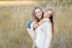 Portrait of two beautiful sisters Stock Photos